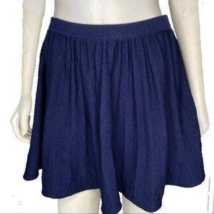 St John Collection navy knit pleated mini skirt
